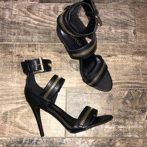 NWOB Liliana black heels with gold zipper accents